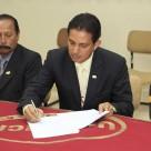 Firmando el acta de evaluacion